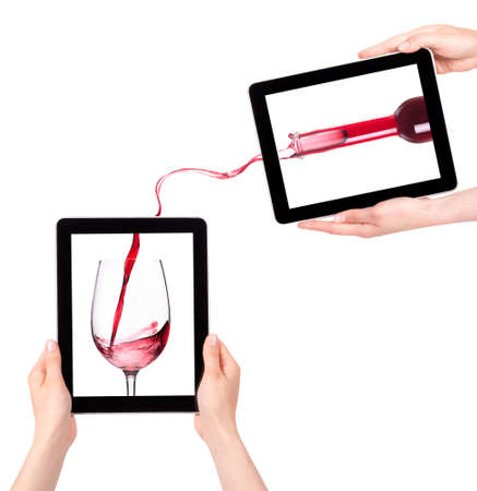 hand holding bottle: isolated Hands Holding Digital Tablet with Red wine splashing