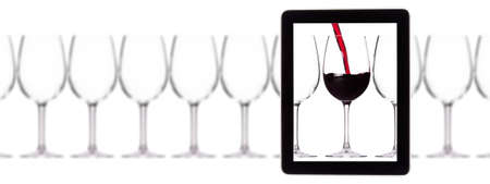 glass of red wine on tablet computer screen isolated on a white background Stock Photo - 15333124