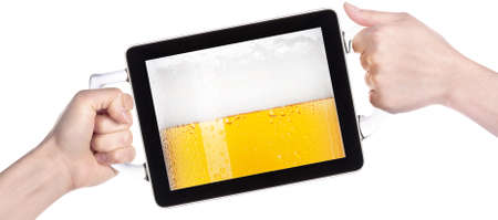 hands holding Touch screen tablet computer with beers making toast photo