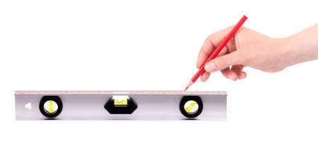 hand drawing red line using a spirit level isolated on a white background photo