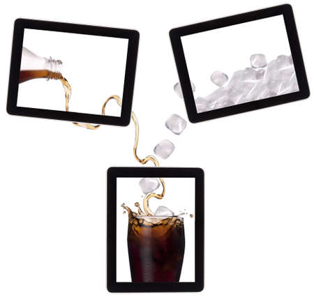 lot of ice drop in to the fresh coke on a digital tablet screen  communication concept photo
