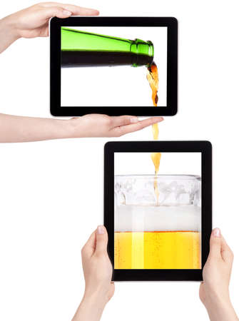 beer pouring from bottle in to the glass on a tablet screen isolated  on a white background photo