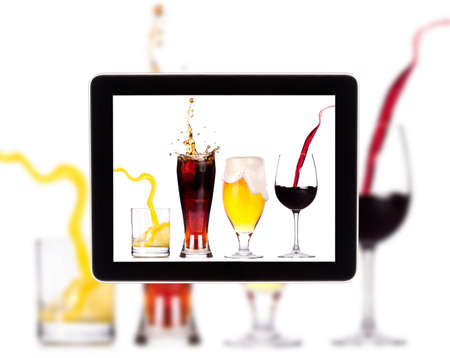 Collection of different images of alcohol on a Digital Tablet screen photo
