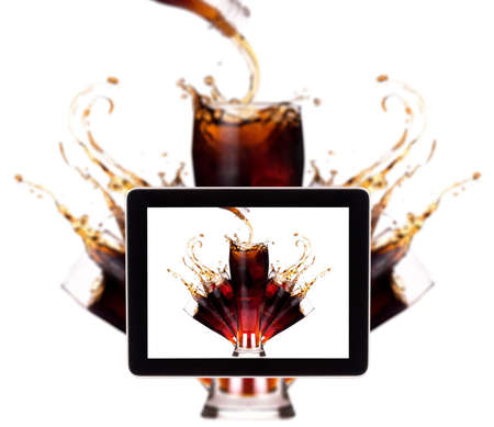 Fresh drinks background with splash isolated on a digital tablet screen photo