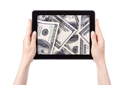lot of cash on a Tablet pc screen with woman hands isolated on a white background photo