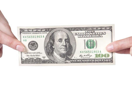 letra de cambio: manos femeninas con dólares aislado en un fondo blanco Foto de archivo