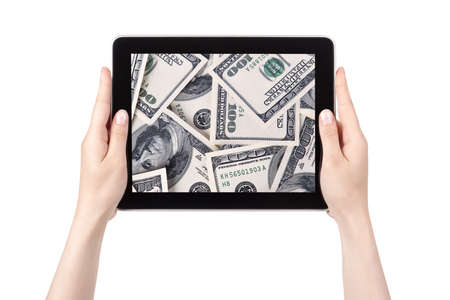 lot of cash on a Tablet pc screen with woman hands isolated on a white background Stock Photo - 15731238