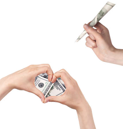 arrow of dollars with the heart  made of two women hands  love money concept photo