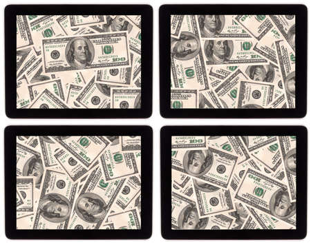 lot of money on a Tablet pc screen  isolated on a white background photo