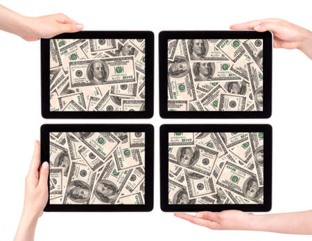 lot of money on a Tablet pc screen with woman hands isolated on a white background Stock Photo - 15900318