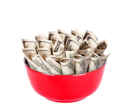 Concept image of food money - red plate full of american money isolated Stock Photo - 15968624