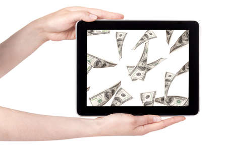 lot of money on a Tablet pc screen with woman hands isolated on a white background Stock Photo - 15968754