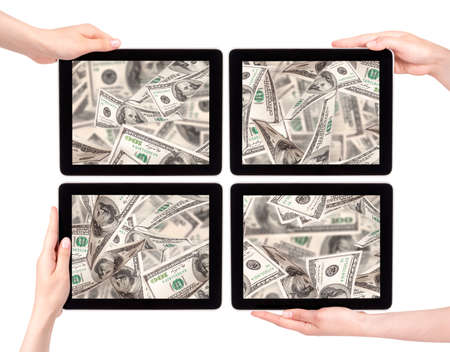 lot of money on a Tablet pc screen with woman hands isolated on a white background Stock Photo - 16215224