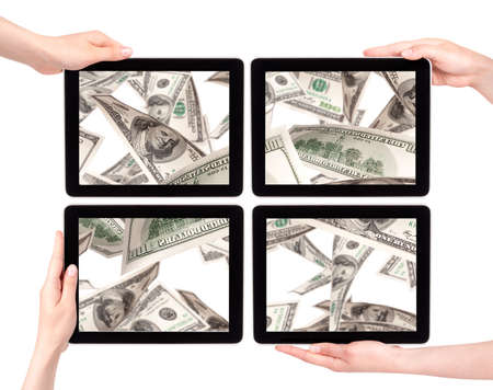 lot of money on a Tablet pc screen with woman hands isolated on a white background Stock Photo - 16215230