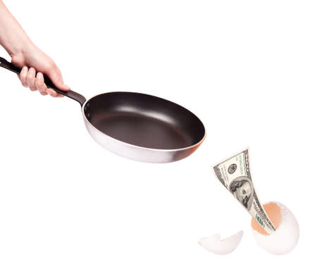 emerge: financial kitchen concept-Frying pan with money emerge from egg shell Stock Photo