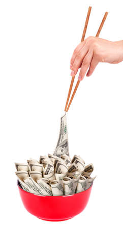 Concept image of food money - red plate full of money and Chinese chopsticks isolated Stock Photo - 16281136