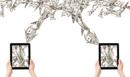 making money with computer concept - Money pouring out from a Tablet pc photo
