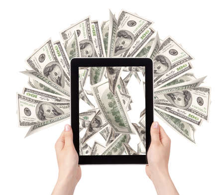 lot of money on a Tablet pc screen with woman hands isolated on a white background Stock Photo - 16281144