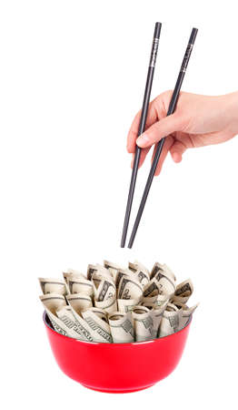 Concept image of food money - red plate full of money and Chinese chopsticks isolated Stock Photo - 16281140