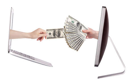 computer and laptop - making money concept isolated with woman hand photo
