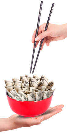 Concept image of food money - red plate full of money and Chinese chopsticks isolated Stock Photo - 16402147