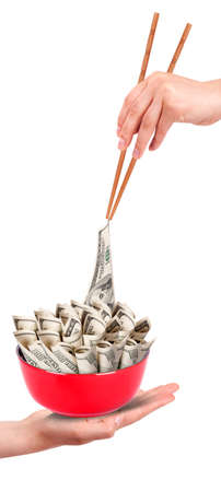 Concept image of food money - red plate full of money and Chinese chopsticks isolated Stock Photo - 16402141