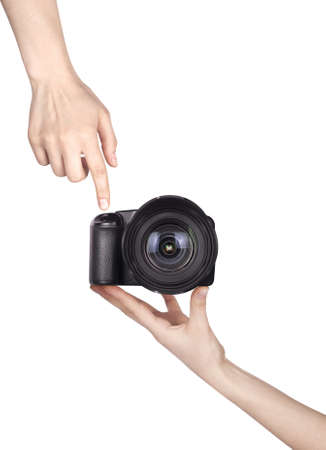 professional digital photo camera with woman hand isolated on white photo