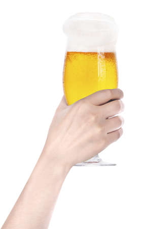 holding close: Frosty glass of beer with hand making toast