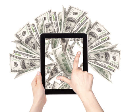 lot of money on a Tablet pc screen with woman hands isolated on a white background Stock Photo - 16478625