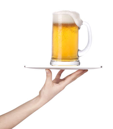 Waitresses hand holding a silver serving tray with a glass of beer  isolated photo