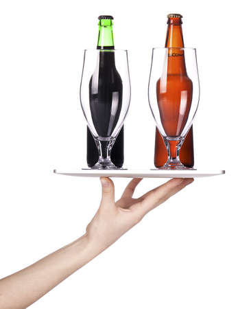 Waitresses hand holding a silver serving tray with beer  isolated photo