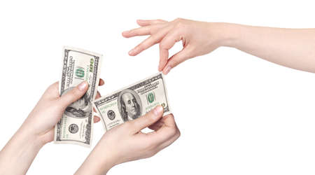 lend a hand: Hand giving money to other hand isolated  on white background Stock Photo