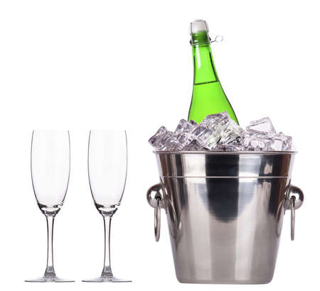 Champagne bottle in a bucket with ice on the white background Stock Photo - 16754873