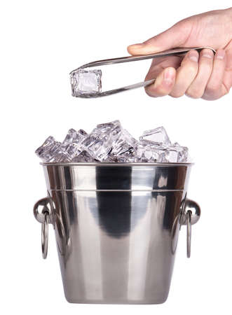 ice bucket isolated with hand holding Ice tongs isolated on a white background photo