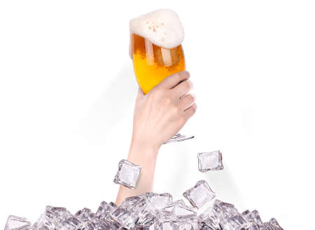 hand with glass of beer  breaks the ice isolated on a white background Stock Photo - 16810392