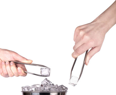 ice tongs: ice bucket  with hand holding Ice tongs isolated on a white background Stock Photo
