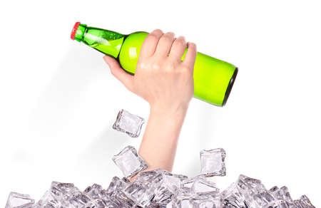 hand with bottle of beer  breaks the ice isolated on a white background Stock Photo - 16810388