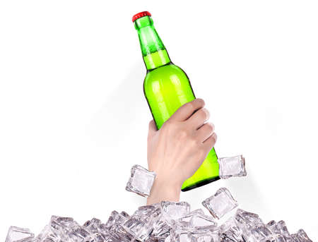 hand with bottle of beer  breaks the ice isolated on a white background Stock Photo - 16810386