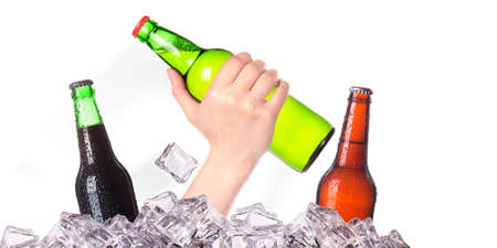 hand with bottle of beer  breaks the ice isolated on a white background Stock Photo - 16810402