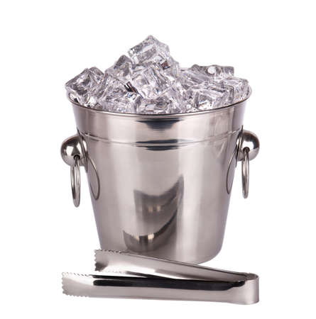 full of ice bucket with  Ice tongs isolated on a white background photo