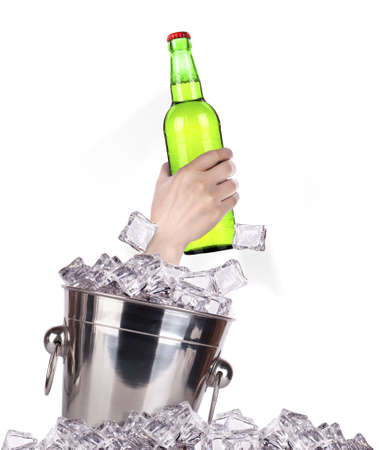hand with bottle of beer  breaks the ice isolated on a white background photo