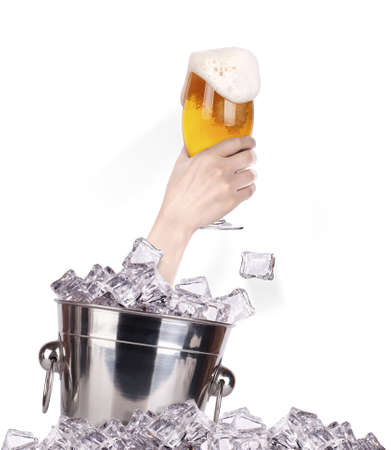 hand with glass of beer  breaks the ice isolated on a white background photo