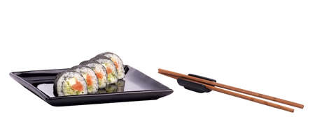 philadelphia roll: Sushi - Roll on a black plate with chopsticks isolated