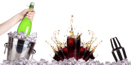 Champagne bottle in ice bucket and fresh cola on the white background photo