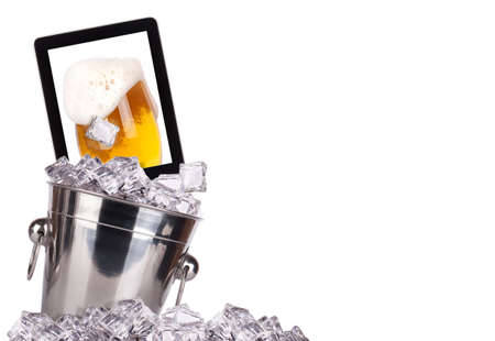 computer beer concept - beer on a digital tablet screen in ice bucket isolated photo