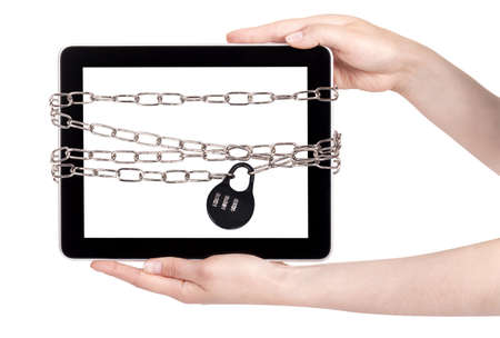 Tablet PC wrapped in chains security concept isolated photo