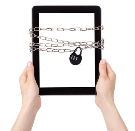 Tablet PC wrapped in chains security concept isolated Stock Photo - 16922578