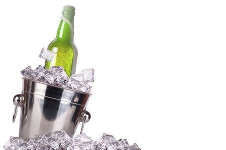 beer bottle in ice bucket isolated on a white background photo