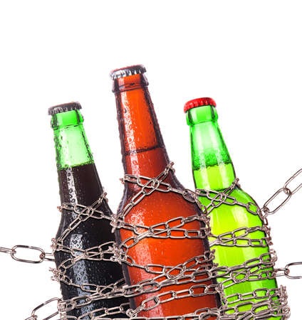 alcohol abuse concept - background with beer locked on a chain  isolated Stock Photo - 16976482