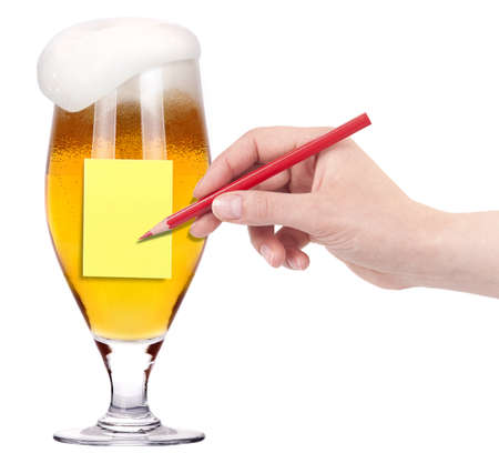 Hand with pencil ready to note message on a glass of beer isolated photo